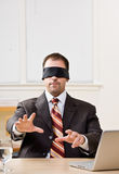 Businessman in blindfold Royalty Free Stock Photo