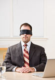 Businessman in blindfold Stock Photos