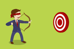 Businessman blindfolded archer cartoon vector Royalty Free Stock Image