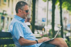 Businessman working outdoors with notebook stock photos