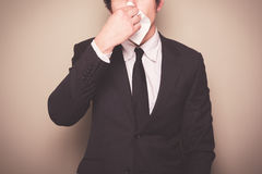 Businessman blowing his nose Royalty Free Stock Photo