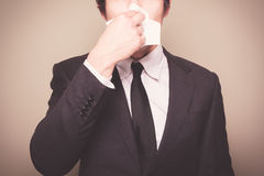 Businessman blowing his nose Royalty Free Stock Photography