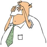 Businessman blowing his nose Stock Photo