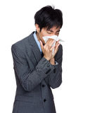 Businessman blowing nose Royalty Free Stock Image