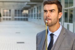 Businessman blowing a whistle isolated royalty free stock photos