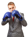 Businessman with blue boxing gloves. With attitude pose. Isolated on white background Stock Photography