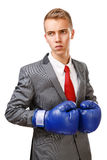 Businessman with blue boxing gloves Royalty Free Stock Images