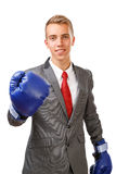 Businessman with blue boxing gloves Stock Photo