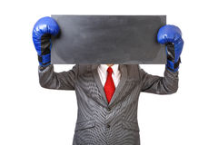 Businessman with blue boxing gloves Royalty Free Stock Photos