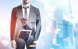 Businessman in a blue city Stock Photo