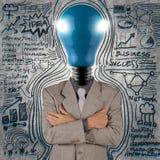 Businessman with blue light bulb head Royalty Free Stock Photos