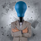 Businessman with blue light bulb head as concept Royalty Free Stock Photography