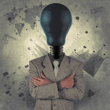 Businessman with blue light bulb head as concept Stock Photos