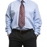 Businessman in blue shirt standing with hands in pockets Stock Image