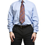 Businessman in blue shirt stands with hands on the hips Stock Images