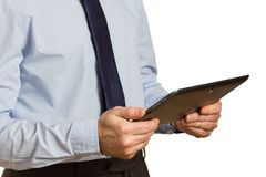 Businessman in blue shirt and tie with computer tablet in hand Stock Photo