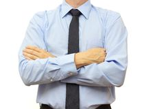 Businessman with blue shirt and tie with crossed hands.  Stock Image