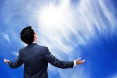 Businessman on blue sky background Royalty Free Stock Photo