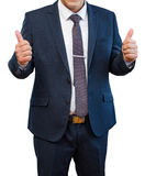 Businessman in blue suit showing Like fingers on a white backgro Stock Image