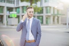 businessman in blue suit talks by phone royalty free stock images