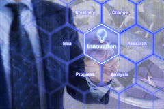 Businessman in blue suit touching a hexagon grid with innovation Royalty Free Stock Photography
