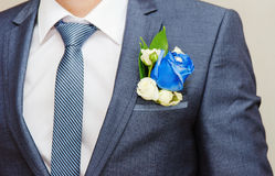 Businessman in blue suit tying. The necktie Royalty Free Stock Photo