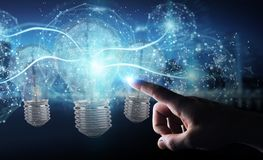 Businessman connecting modern lightbulbs with connections 3D ren. Businessman on blurred background connecting modern lightbulbs with connections 3D rendering Royalty Free Stock Photos