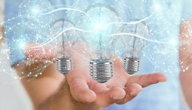 Businessman connecting modern lightbulbs with connections 3D ren. Businessman on blurred background connecting modern lightbulbs with connections 3D rendering Stock Photo
