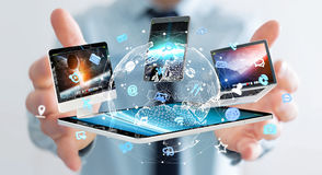 Businessman connecting tech devices to each other 3D rendering Royalty Free Stock Image