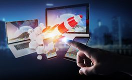Businessman connecting tech devices and startup rocket 3D render. Businessman on blurred background connecting tech devices and startup rocket 3D rendering Stock Photos