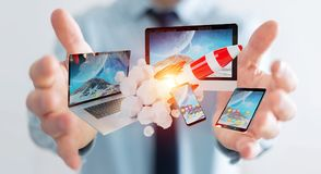 Businessman connecting tech devices and startup rocket 3D render. Businessman on blurred background connecting tech devices and startup rocket 3D rendering Royalty Free Stock Photo