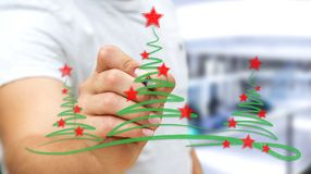 Businessman drawing christmas trees sketch. Businessman on blurred background drawing christmas trees sketch Royalty Free Stock Photo