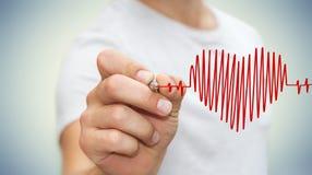 Businessman drawing a heart beat sketch Stock Photos