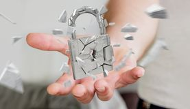 Businessman hacking in broken padlock security 3D rendering. Businessman on blurred background hacking in broken padlock security 3D rendering Stock Photo