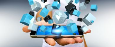 Businessman holding floating blue shiny cube network 3D renderin. Businessman on blurred background holding floating blue shiny cube network 3D rendering Royalty Free Stock Photo