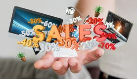 Businessman holding sales icons in his hand 3D rendering. Businessman on blurred background holding sales icons in his hand 3D rendering Stock Images