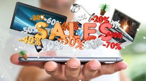 Businessman holding sales icons over his phone 3D rendering. Businessman on blurred background holding sales icons over his phone 3D rendering Royalty Free Stock Images