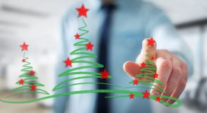 Businessman holding and touching christmas trees sketch. Businessman on blurred background holding and touching christmas trees sketch Royalty Free Stock Image