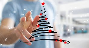 Businessman holding and touching christmas trees sketch. Businessman on blurred background holding and touching christmas trees sketch Stock Photos
