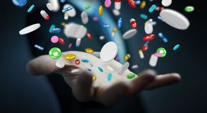 Businessman holding and touching floating medicine pills 3D rend Stock Images