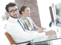 Businessman on blurred background office Stock Image