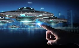 Businessman with retro UFO spaceship 3D rendering. Businessman on blurred background with retro UFO spaceship 3D rendering Stock Images