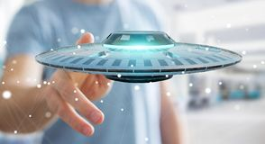 Businessman with retro UFO spaceship 3D rendering. Businessman on blurred background with retro UFO spaceship 3D rendering Stock Photo
