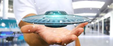Businessman with retro UFO spaceship 3D rendering. Businessman on blurred background with retro UFO spaceship 3D rendering Royalty Free Stock Photo