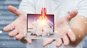 Businessman with rocket launching from a laptop 3D rendering. Businessman on blurred background with rocket launching from a laptop 3D rendering Stock Photography