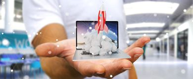 Businessman with rocket launching from a laptop 3D rendering. Businessman on blurred background with rocket launching from a laptop 3D rendering Royalty Free Stock Photo