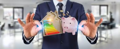 Businessman saving money with good energy chart rating 3D render. Businessman on blurred background saving money with good energy chart rating 3D rendering Royalty Free Stock Photography