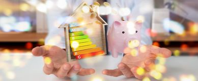 Businessman saving money with good energy chart rating 3D render. Businessman on blurred background saving money with good energy chart rating 3D rendering Stock Photography