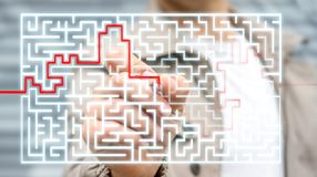 Businessman searching solution of a complicated maze. Businessman on blurred background searching solution of a complicated maze Stock Photography