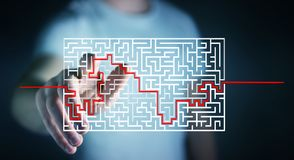Businessman searching solution of a complicated maze. Businessman on blurred background searching solution of a complicated maze Stock Photos